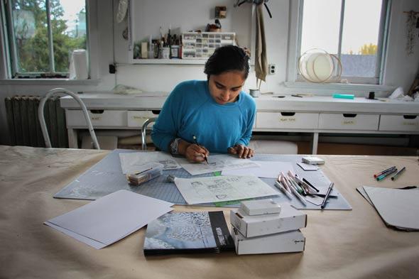 Multidisciplinary conceptual artist Satpreet Kahlon works on some sketches in her studio in Fort Worden's Building 205.